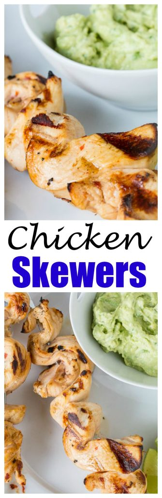 close up of grilled chicken on skewers with avocado dipping sauce on a plate