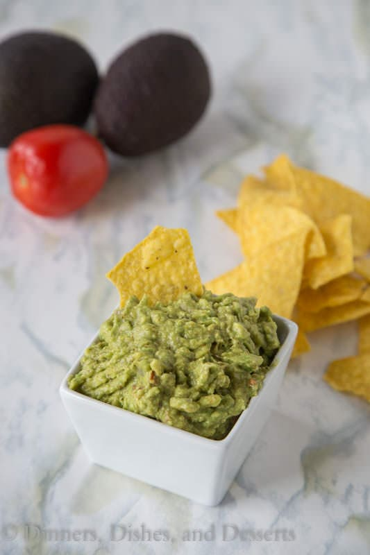 Homemade Guacamole - super easy dip recipe with ripe avocados, tomatoes, onions and a couple spices.  Perfect with tortilla chips.