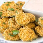 Zucchini Fritters - zucchini coated in taco seasoning breadcrumbs and baked until crispy! Served with a creamy salsa dipping sauce. Great way to get your family to eat more veggies!