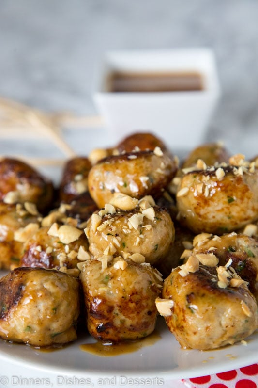 Chicken Meatballs with Peanut Sauce - tender chicken meatballs flavored with cilantro and garlic topped with a peanut sauce and chopped peanuts. Great as an appetizer or main course.