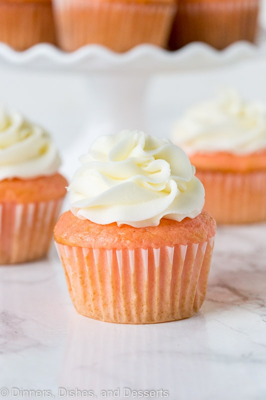 strawberry almond cupcakes topped with frosting