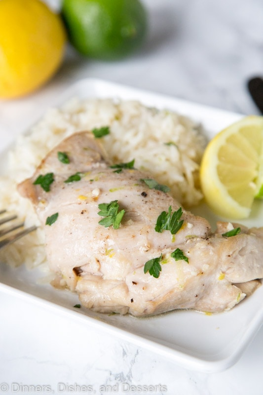 citrus garlic chicken with coconut lime rice on a plate