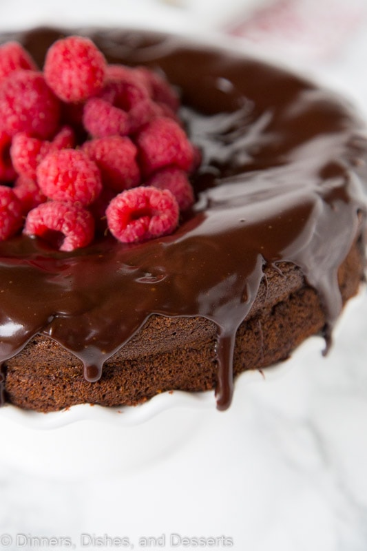 A close up of a piece of chocolate cake on a plate, with Flourless chocolate cake and Hazelnut