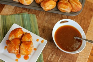 Pumpkin Caramel Monkey Bread Muffins with bowl of caramel