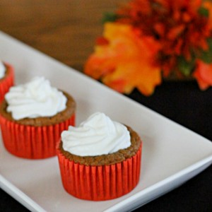 pumpkin pie cupcakes on white plate with orange leaves in the background