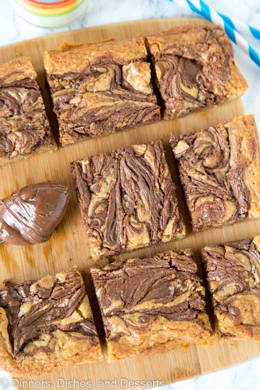 Blondies swirled with nutella on a cutting board