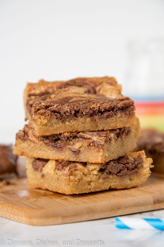 Blondies swirled with nutella stacked on a cutting board