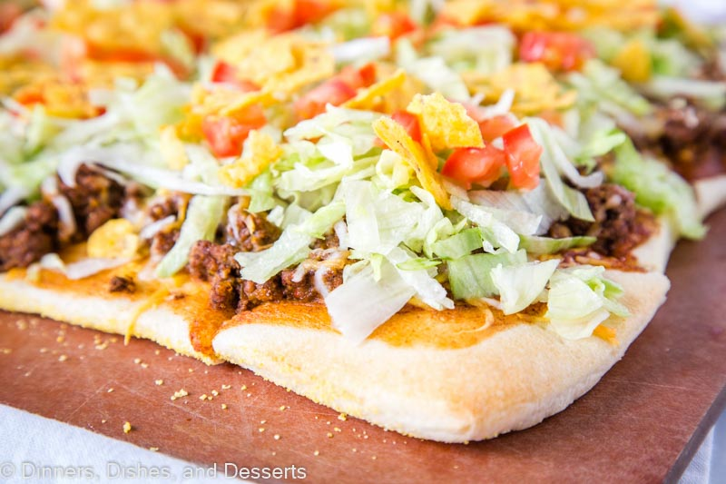 Taco Pizza - A super easy pizza recipe with all the flavors of taco night!  A fun dinner the entire family will love!