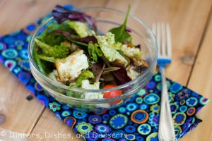 bread salad in glass bowl on flowered napkin