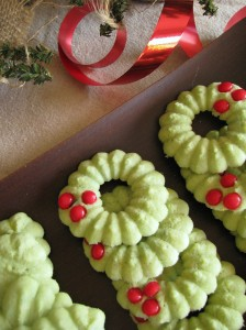 stacks of Holly Wreaths cookies with red ribbon