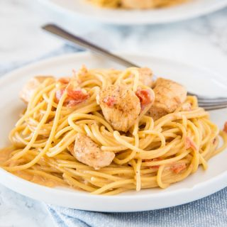 Creamy Cajun Chicken Pasta - Get dinner on the table fast with this creamy pasta full of spicy creole seasoning, tomatoes, and chicken!