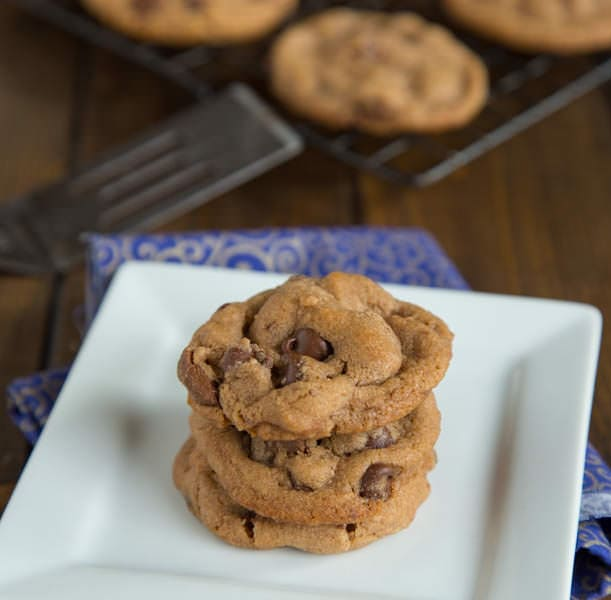 Malted Double Chocolate Chip Cookies stacked on white plate