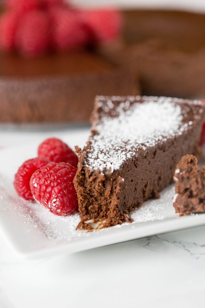 A piece of chocolate cake on a plate, with Flourless chocolate cake