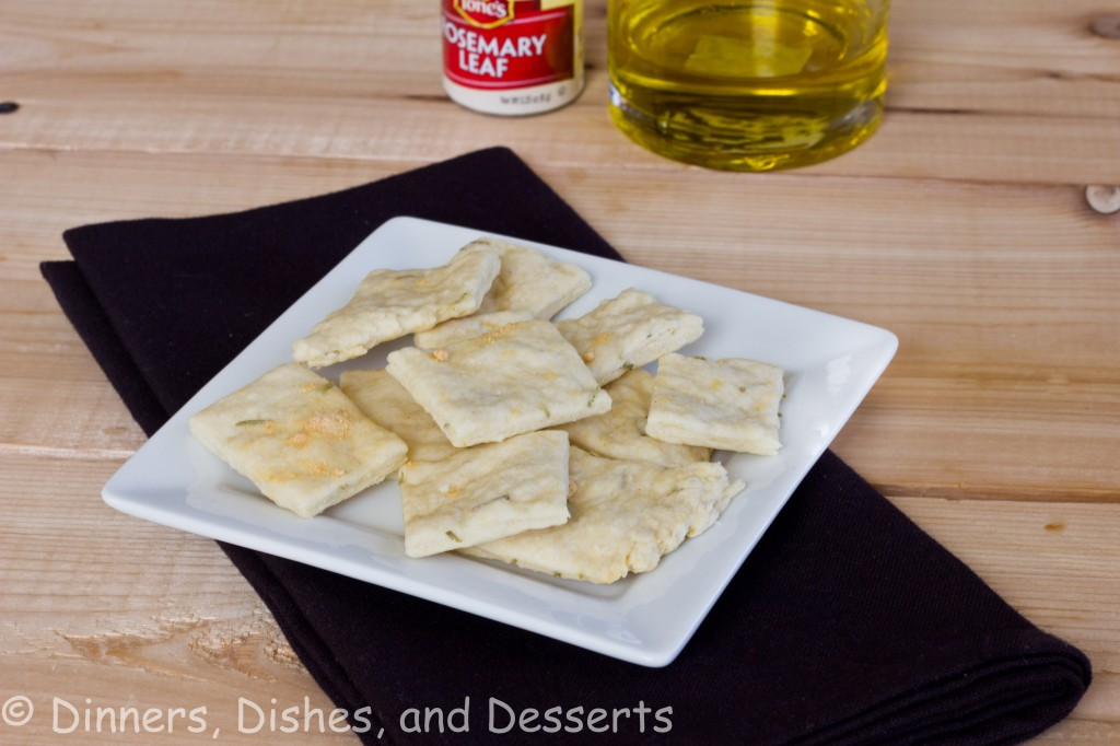 Rosemary Olive Oil Crackers on white plate with black napkin