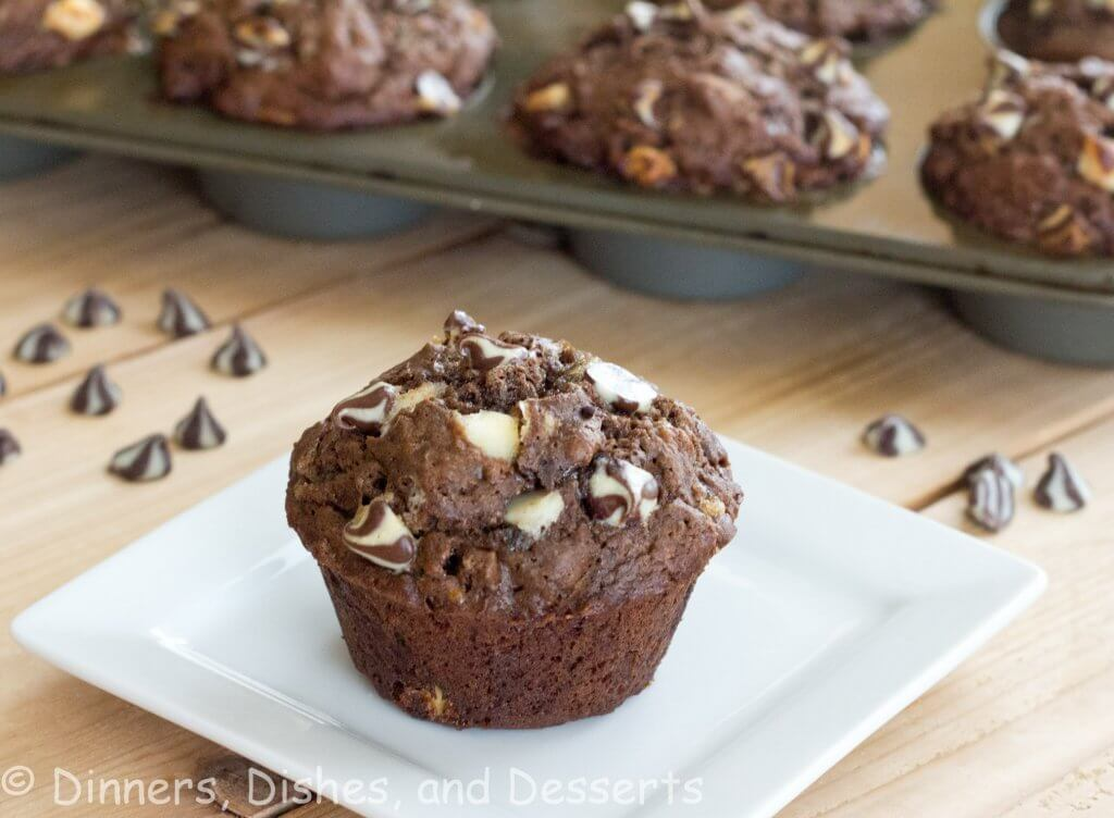 chocolate banana white chocolate chip muffins on a plate