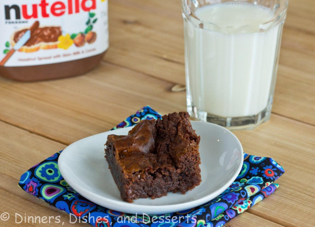 nutella brownie on white plate with glass of milk