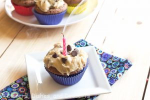 brownie cupcakes with cookie dough frosting on a plate