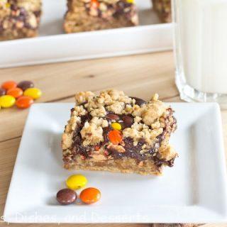 peanut butter polka dot bars on a plate