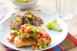 grilled chicken with an avocado tomato salsa on a plate