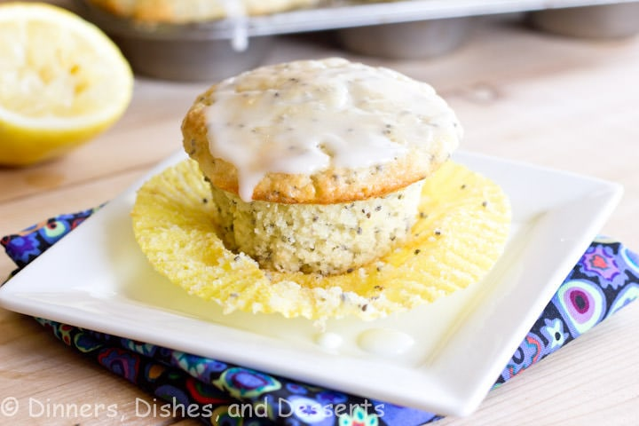 Lemon Chia Seed Muffins - Super moist and light lemon muffins with chia seeds. Made with Greek yogurt. Complete with a light glaze!