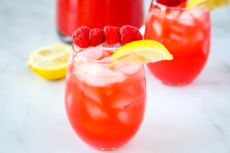 Raspberry Lemonade - Pureed raspberries give fresh squeezed lemonade such a great new flavor!  So easy to make and the perfect refreshing summer drink!