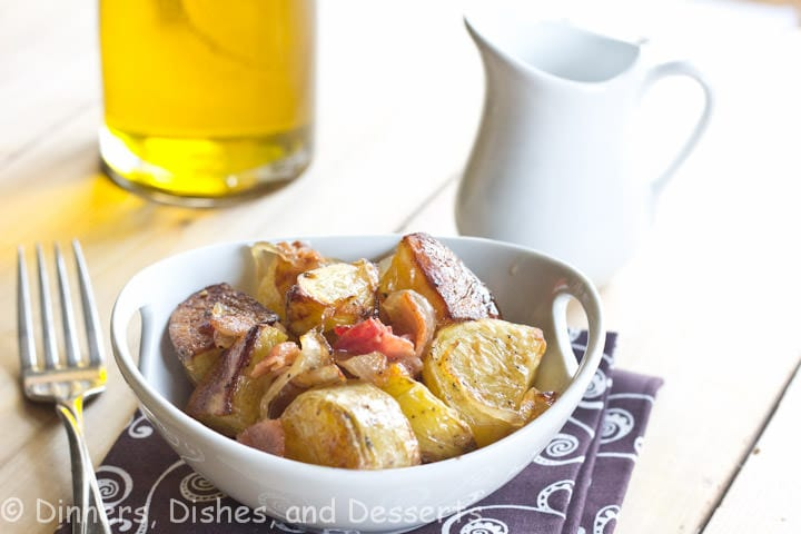 roasted potato salad with caramelized onions and bacon in a bowl