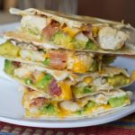 Quesadillas are a very versatile easy dinner to get on the table. This version is filled with crispy bacon, chicken, and buttery avocado. Great for busy school nights.