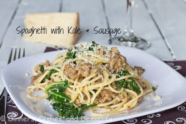 spaghetti with kale and sausage on a plate