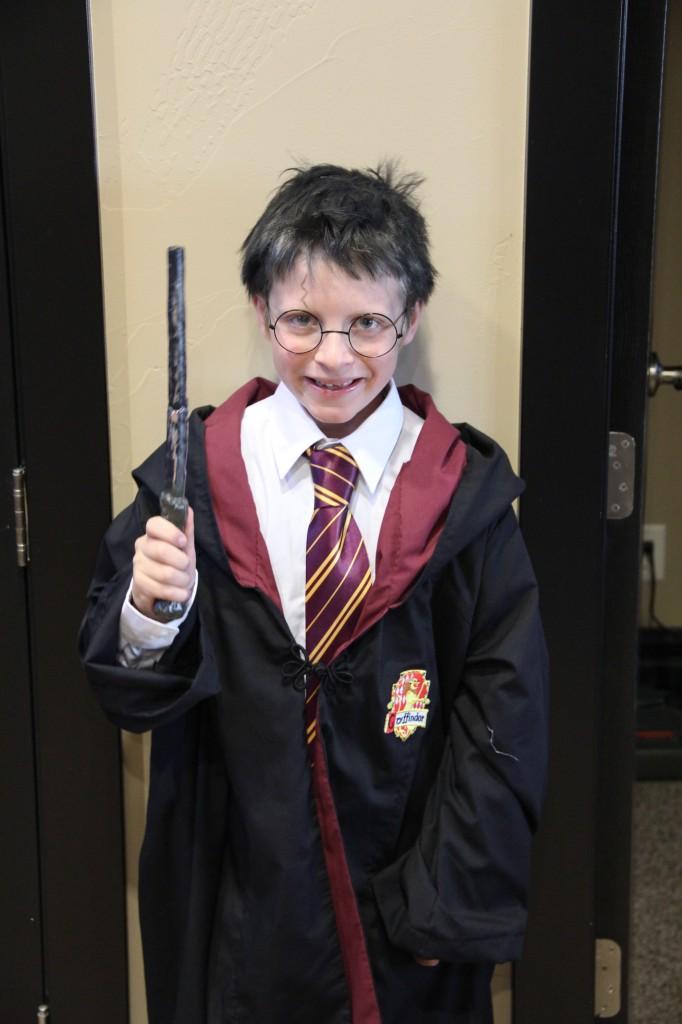 kid dressed as harry potter