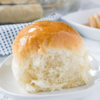 A dinner roll on a plate