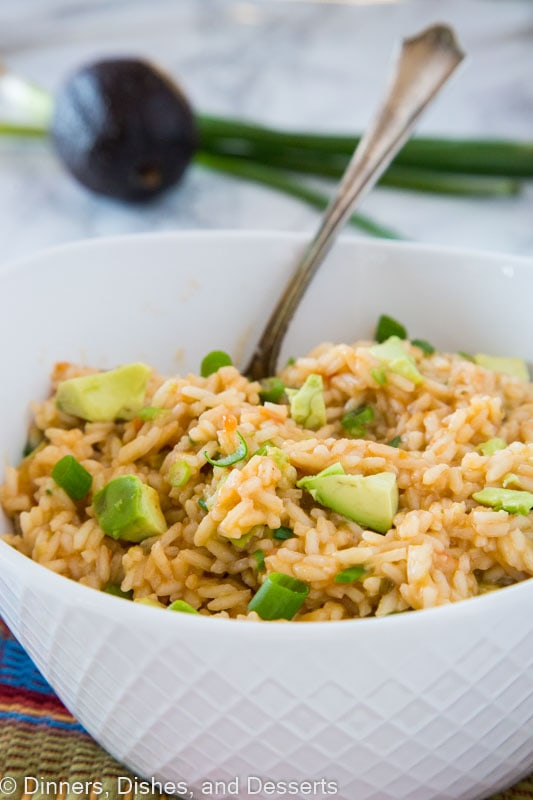 Mexican Rice - A Mexican style rice, that happens to be good for you. It is full of scallions and chunks of avocado. So good and a staple anytime we have Mexican food!