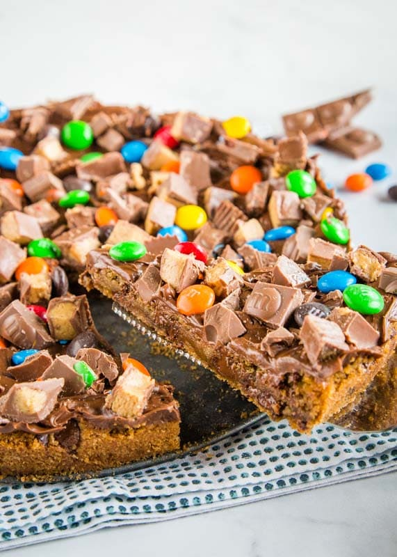 Dessert pizza made with chocolate chip cookies and all sorts of candy