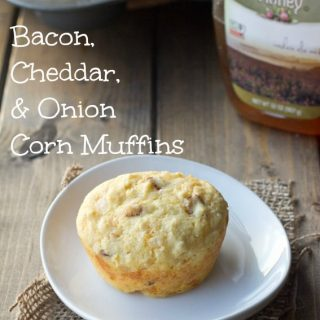 bacon onion and cheddar corn muffins on a plate