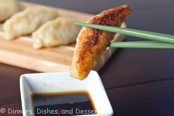 pan fried shrimp and pork potstickers on a board