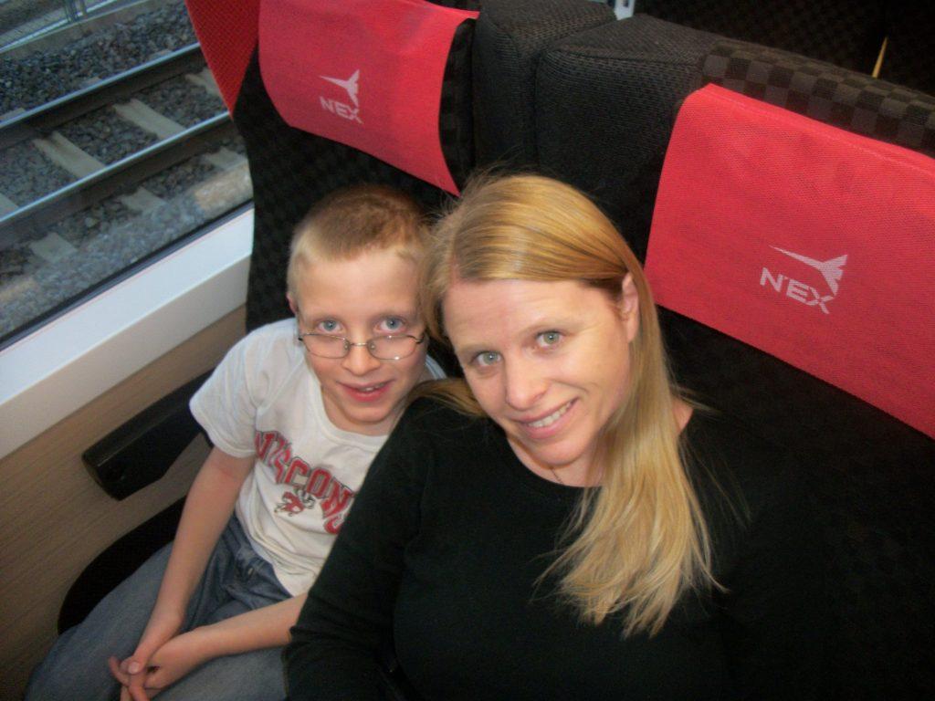 A young boy sitting on a train