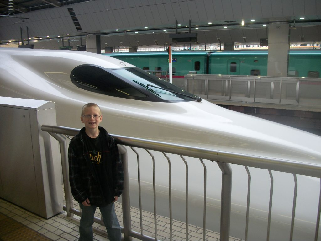 A person standing in front of a train