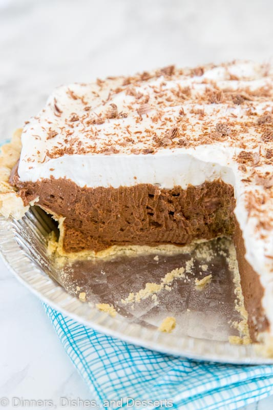 French Silk Pie - a rich and creamy chocolate pie with a layer of silky chocolate mousse topped with fresh whipped cream and chocolate shavings!