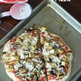 roasted veggie pizza on a pan