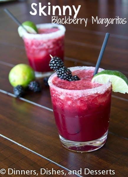 A cup of margarita on a table, with Margarita and Blackberry