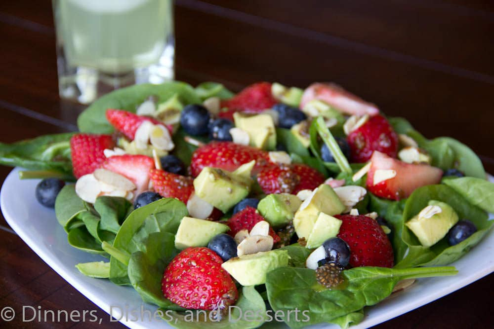 berry almond salad with chia seed vinaigrette on a plate