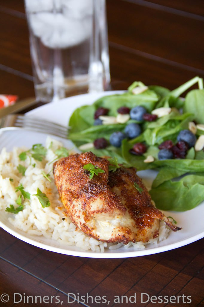 spiced chicken thighs with garlicky rice on a plate