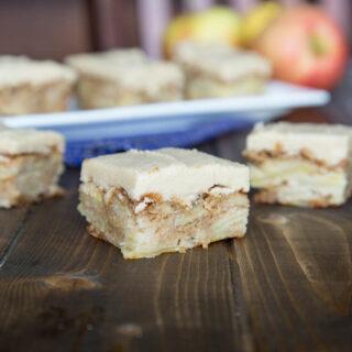 apple blondies w cinnamon brown sugar frosting on a table
