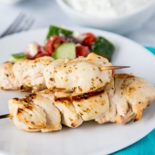 Chicken Souvlaki Skewers with Tzatziki Sauce - tender pieces of Greek chicken that are marinated and grilled to perfection.  Served with Tzatziki dipping sauce for a great weeknight dinner.