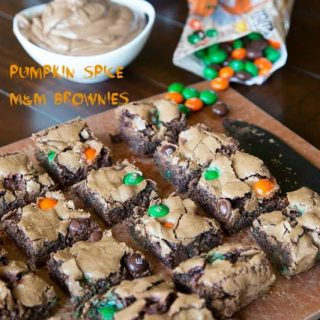 pumpkin spiced m&m brownies on a plate