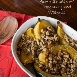 acorn squash with rosemary and walnuts in a bowl
