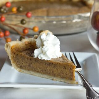 Pumpkin Pie - Homemade pumpkin pie is the ultimate pie for the holidays. Super easy to make and full of delicious spices.