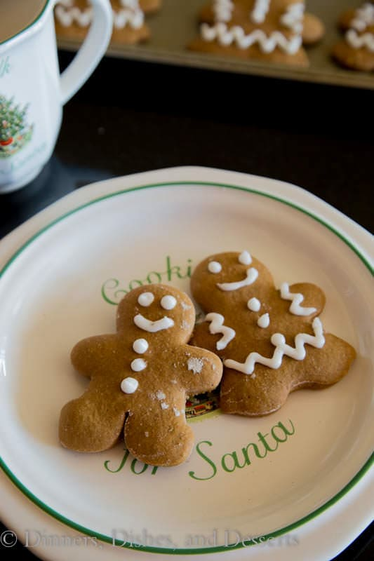 Gingerbread Men Cookies - classic Christmas cookies full of all those delicious spices.  Decorated with white frosting to make them extra fun and festive.