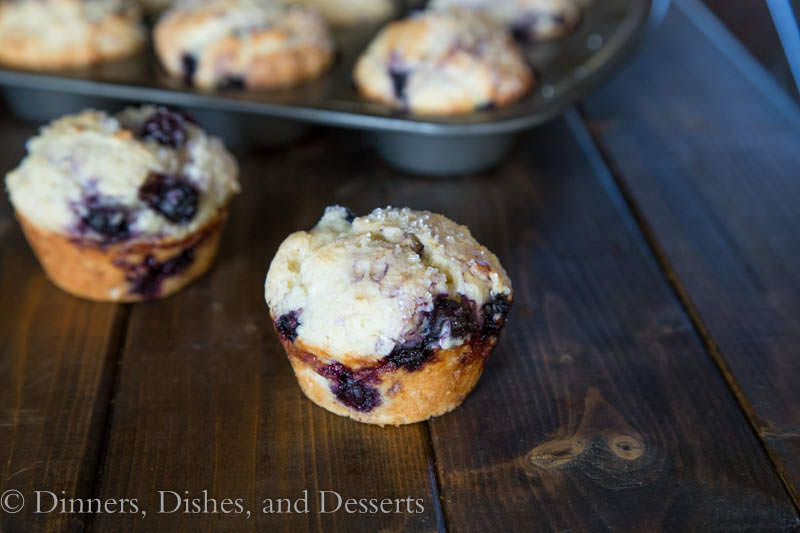 bakery style blueberry muffins on a board