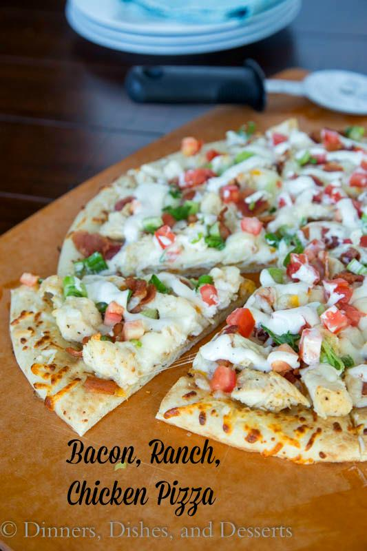 chicken bacon ranch pizza on a board