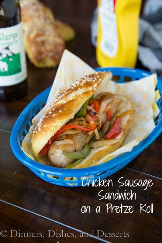 chicken sausage sandwich on a pretzel roll on a plate